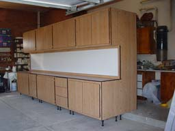 Freestanding garage storage system, 16 foot long workbench on frontside and 16 foot tall storage on backside. Total system is 4 foot deep by 16 foot long by 8 foot high.